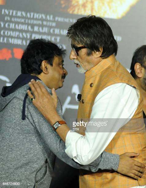 Indian Bollywood actor Amitabh Bachchan embraces director Ram Gopal Varma poses during the launch of the forthcoming Hindi film Sarkar 3 written and...