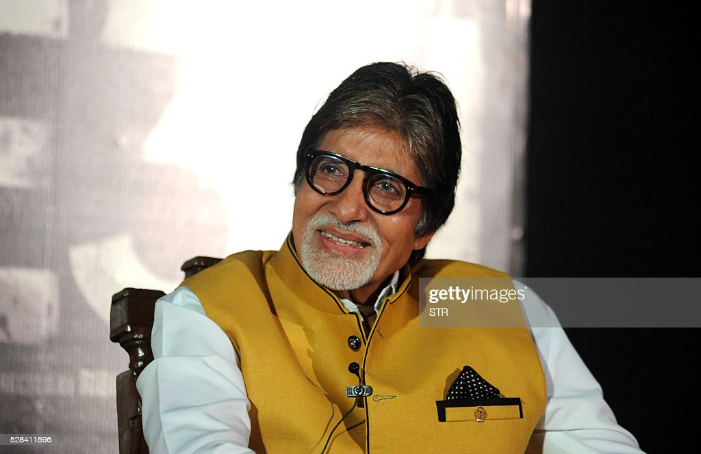 Indian Bollywood actor Amitabh Bachchan gestures as he attends the trailer launch of the forthcoming Hindi film TE3N directed by Ribhu Dasgupta and produced by Sujoy Ghosh in Mumbai on May 5, 2016. / AFP / STR