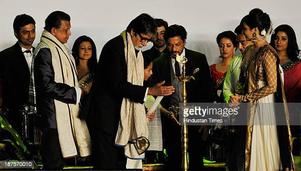 Indian Bollywood actor Amitabh Bachchan lights the inaugural lamp at the inaugural ceremony of 19th Kolkata International film Festival and actors...