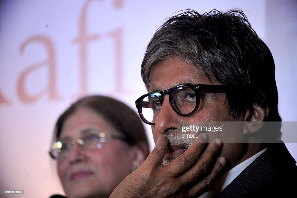 """Indian Bollywood actor Amitabh Bachchan (R) looks on during the unveiling of the book """"Mohammed Rafi My Abba- A Memoir"""" by Yasmin K.Rafi in Mumbai on November 25, 2012."""