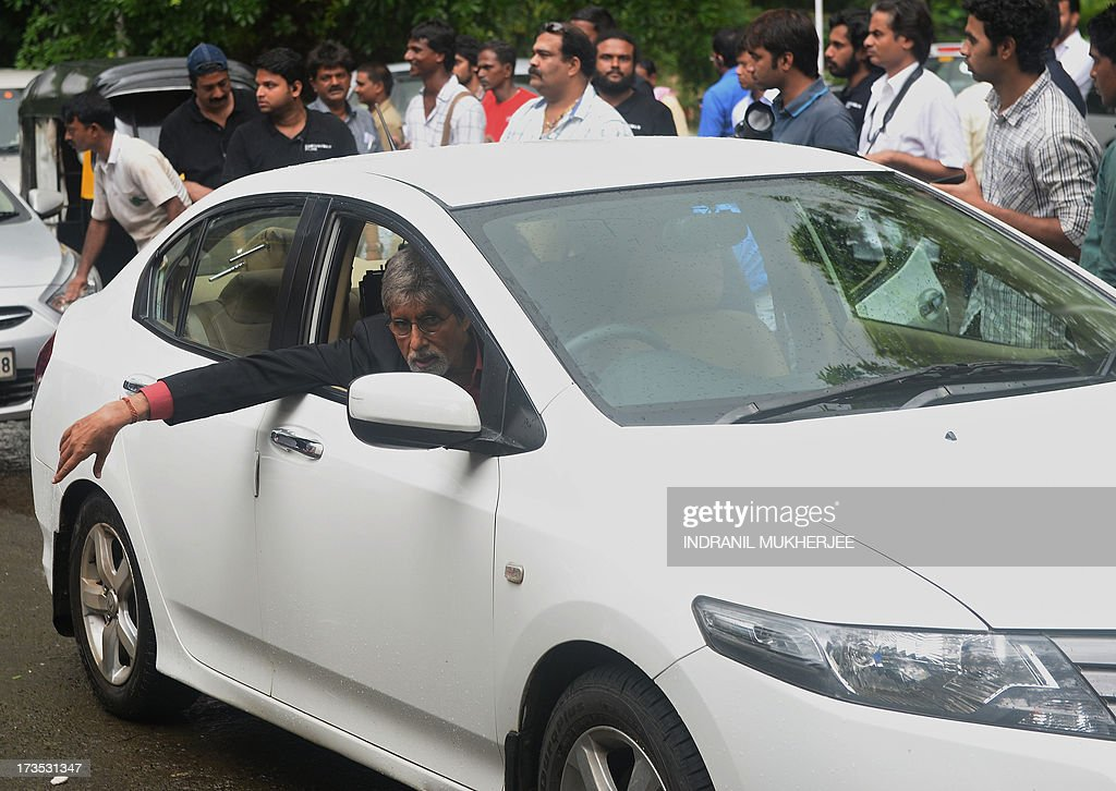 Indian Bollywood actor Amitabh Bachchan looks out of a car as he shoots a television coomercial for a leading jewellery house in Mumbai on July 16, 2013. Bachchan, 71, is still one of the most sought after filmstars for endorsing brands from shampoo to shoe lace. Known universally as 'The Big B', Amitach Bachchan made his name as the 'angry young man' of Hindi cinema. He starred in more than 150 films including the 1970s hits 'Sholay' (Embers), 'Deewaar' (The Wall) and 'Don'.