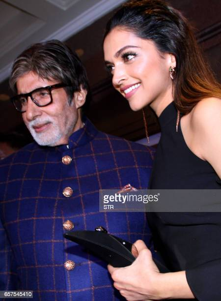 Indian Bollywood actor Amitabh Bachchan poses with actress Deepika Padukone as they attend the 'HT Most Stylish' awards ceremony in Mumbai late March...