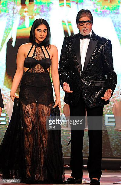 Indian Bollywood actor Amitabh Bachchan poses with actress Regina Cassandra during the announcement of the forthcoming Hindi film Aankhen 2 directed...