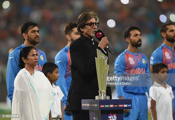 Indian Bollywood actor Amitabh Bachchan sings the Indian national anthem ahead of the start of the World T20 cricket tournament match between India...