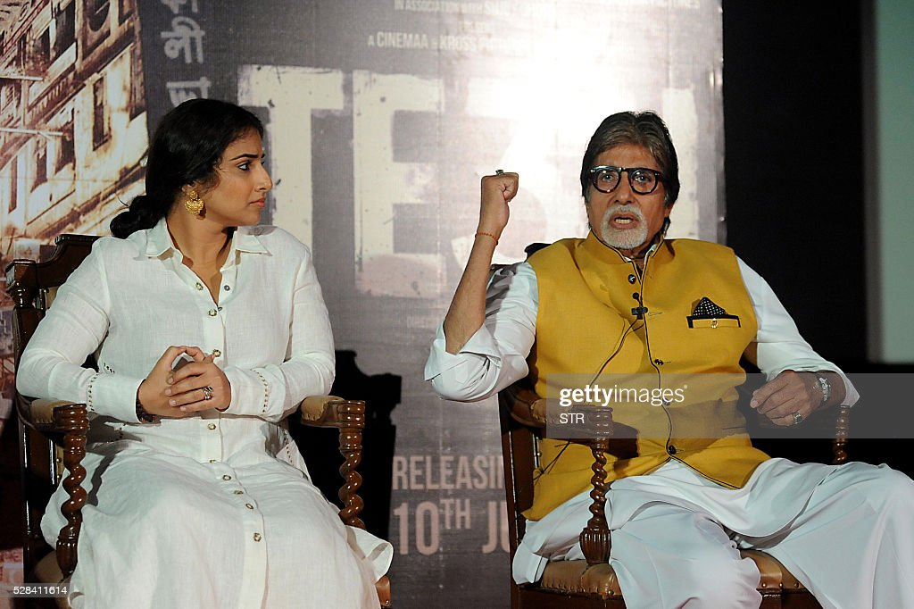 Indian Bollywood actor Amitabh Bachchan(R)and actress Vidya Balan attend the trailer launch of the forthcoming Hindi film TE3N directed by Ribhu Dasgupta and produced by Sujoy Ghosh in Mumbai on May 5, 2016. / AFP / STR