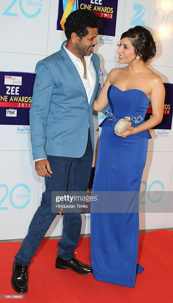Indian bollywood actor and director Prabhudeva with bollywood actress, singer Sophie Choudry attending Zee Cine Awards 2013 at Yash Raj Studio on January 6, 2013 in Mumbai, India.