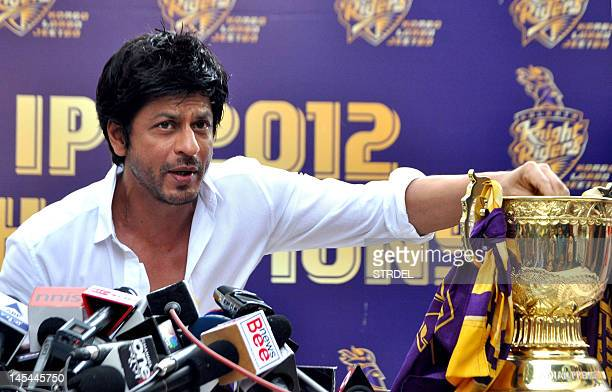 Indian Bollywood actor and Indian Premier League franchise Kolkata Knight Rider's coowner Shah Rukh Khan pictured with the IPL trophy addresses a...