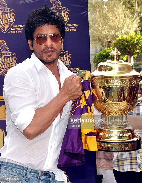 Indian Bollywood actor and Indian Premier League franchise Kolkata Knight Rider's coowner Shah Rukh Khan poses with the IPL trophy during a press...