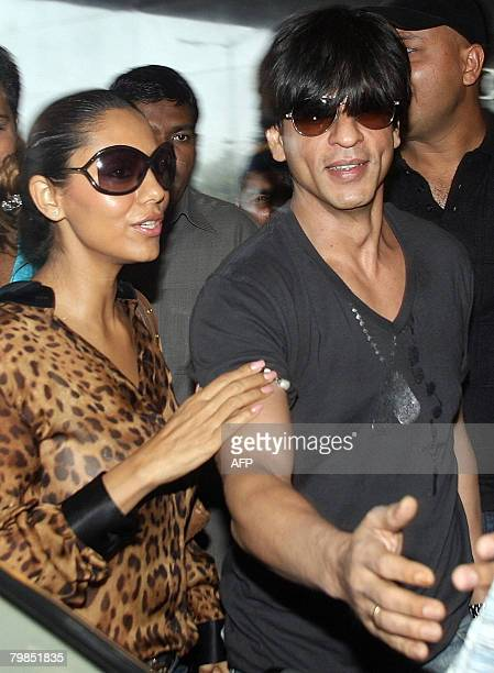 CORRECTION Indian Bollywood actor and owner of the 'Kolkata' cricket team Shahrukh Khan along with wife Gauri arrives for the inaugural Indian...
