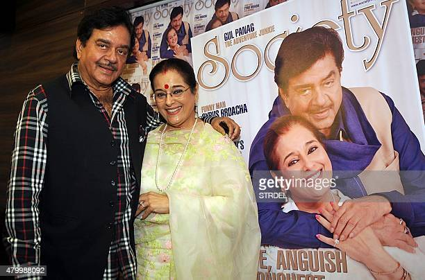 Indian Bollywood actor and politician Shatrughan Sinha poses with his wife and actress Poonam Sinha as they unveil the cover of the July edition of...
