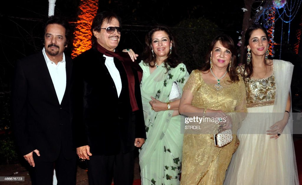 Indian Bollywood actor and producer Akbar Khan (L) and Sanjay Khan (2L) pose with family members as they attend the wedding reception of actress Ahana Deol and husband Vaibhav Vohra in Mumbai on February 2, 2014.