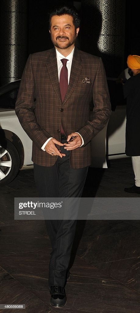 Indian Bollywood actor Anil Kapoor arrives for the wedding reception of Bollywood actor Shahid Kapoor in Mumbai on July 12, 2015.