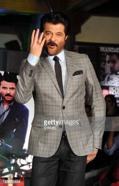 Indian Bollywood actor Anil Kapoor poses for a photo during the unveiling of the May 2013 cover of the magazine Mandate in Mumbai on May 4 2013 AFP...
