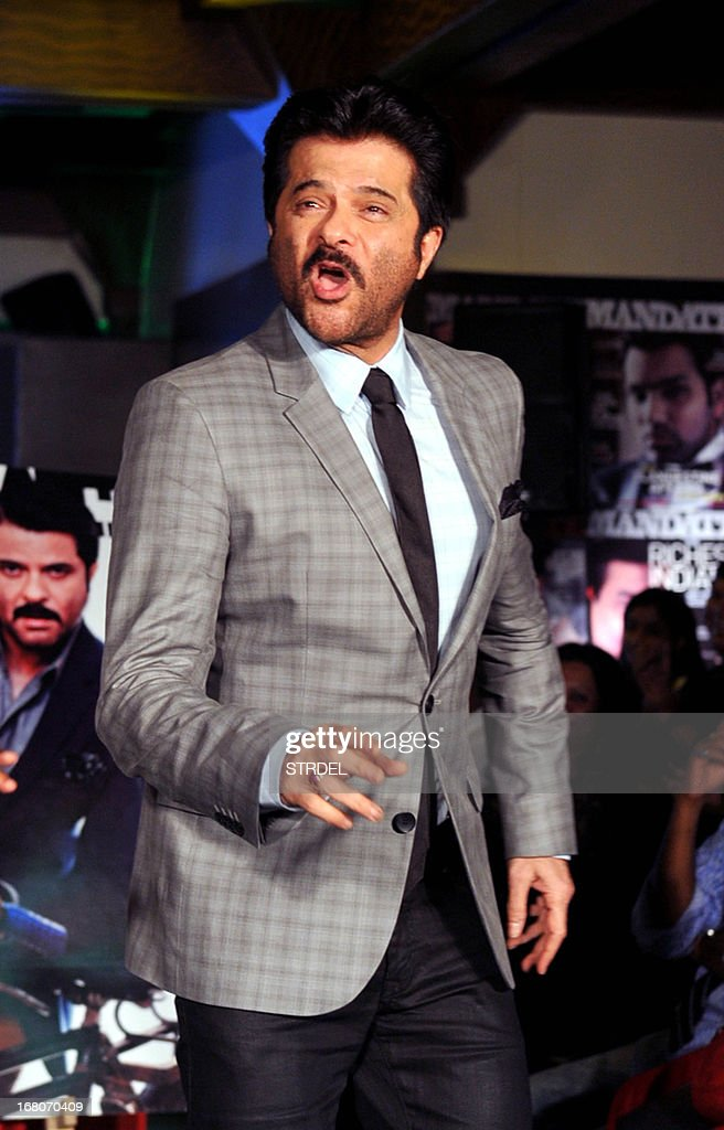Indian Bollywood actor Anil Kapoor poses for a photo during the unveiling of the May 2013 cover of the magazine, Mandate, in Mumbai on May 4, 2013. AFP PHOTO/ STR