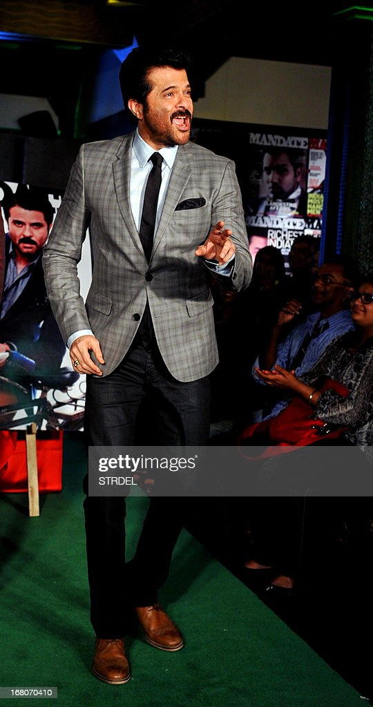 Indian Bollywood actor Anil Kapoor poses for a photo during the unveiling of the May 2013 cover of the magazine, Mandate, in Mumbai on May 4, 2013.
