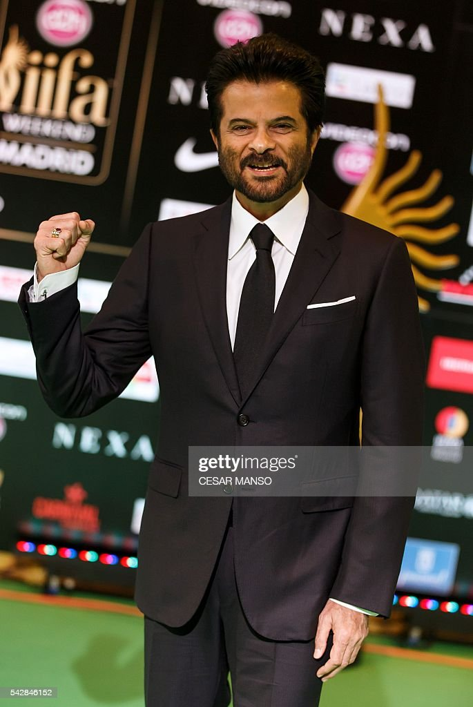 Indian Bollywood actor Anil Kapoor poses on the green carpet as she arrives to the 17th edition of IIFA Awards (International Indian Film Academy Awards) in Madrid on June 24, 2016. The IIFA Awards are presented annually by the International Indian Film Academy to honour both artistic and technical excellence of professionals in Bollywood, the Hindi language film industry. / AFP / CESAR