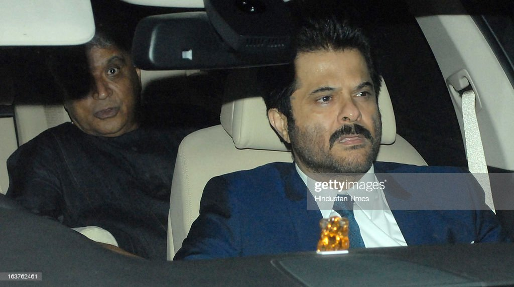 Indian Bollywood actor Anil Kapoor with lyricist and screenwriter Javed Akhtar arriving for the Steven Spielberg's party which is organised by Anil Ambani, chairman of Anil Dhirubhai Ambani Group at Taj President, Cuffe Parade on March 12, 2013 in Mumbai, India. Spielberg is in India to celebrate the success of his film Lincoln, a co-production between his banner DreamWorks and Anil Ambani's Reliance Entertainment.