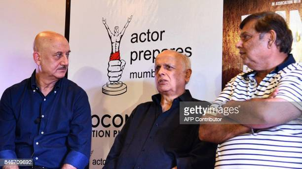 Indian Bollywood actor Anupam Kher film directors Mahesh Bhatt and David Dhawan attend the trailer launch of upcoming Hindi film 'Ranchi Diaries' in...