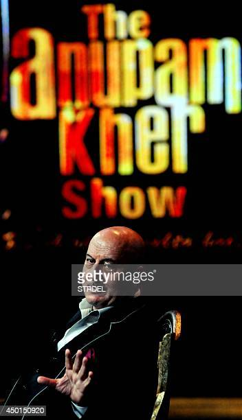 Indian Bollywood actor Anupam Kher poses for a photograph during an appearance on a television show in Mumbai on late June 5 2014 AFP PHOTO/STR