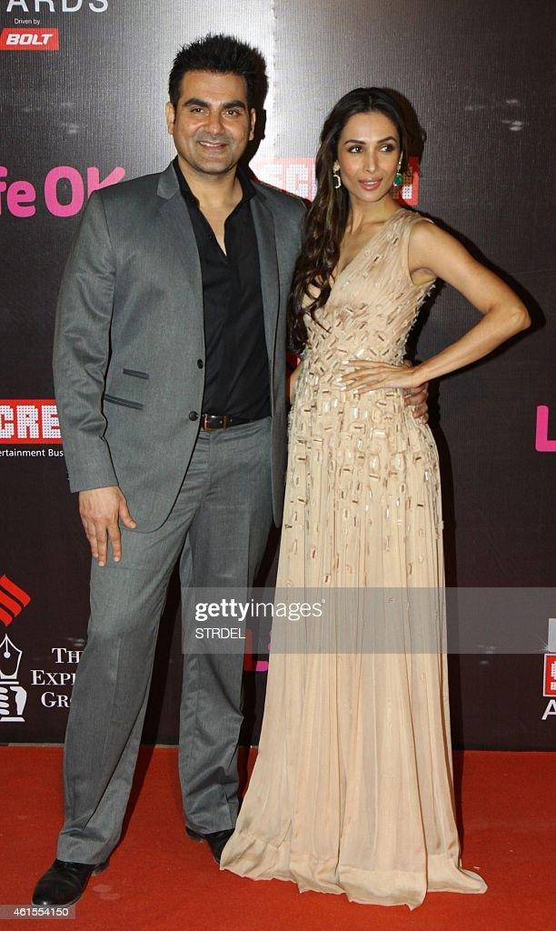 Indian Bollywood actor Arbaaz Khan with his wife actress Malika Arora Khan attend the 'Life OK Screen Awards 2015' in Mumbai on January 14, 2015.