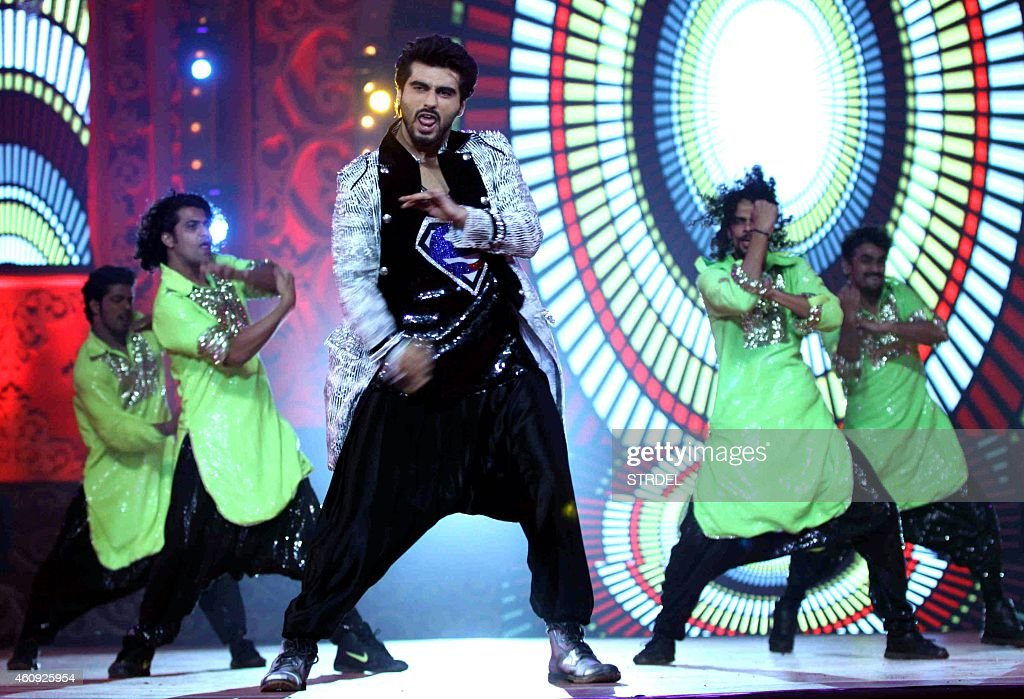 Indian Bollywood actor <a gi-track='captionPersonalityLinkClicked' href=/galleries/search?phrase=Arjun+Kapoor&family=editorial&specificpeople=6147223 ng-click='$event.stopPropagation()'>Arjun Kapoor</a> performs at the BIG STAR Entertainment Awards 2014 in Mumbai on December 18, 2014.