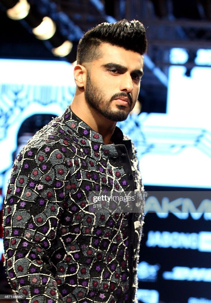 Indian Bollywood actor <a gi-track='captionPersonalityLinkClicked' href=/galleries/search?phrase=Arjun+Kapoor&family=editorial&specificpeople=6147223 ng-click='$event.stopPropagation()'>Arjun Kapoor</a> showcases a creation by designer Kunal Rawal on the fourth day of the Lakme Fashion Week (LFW) summer/resort 2015 in Mumbai on March 21, 2015.