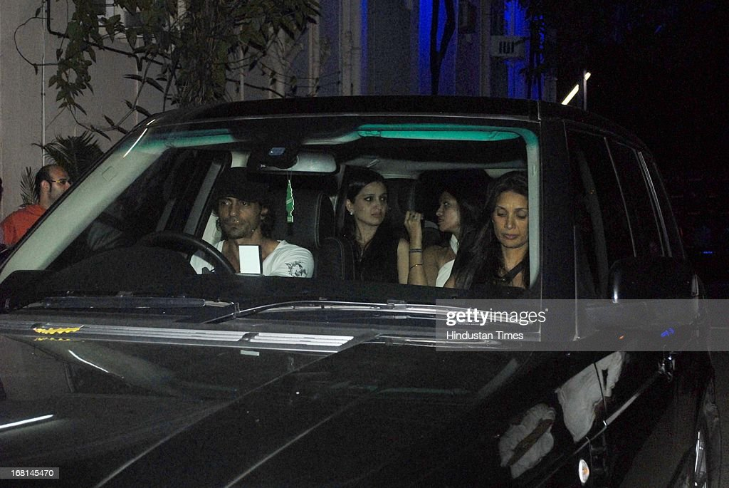 Indian Bollywood actor Arjun Rampal along with his wife Mehr Jesia Rampal arriving at the Blackberrys Sharp Night Fashion Show at Mehboob studio, Bandra on May 3, 2013 in Mumbai, India. The Blackberrys Sharp Night is a fashion show organised by Blackberrys to showcase their new Summer/Spring collection.