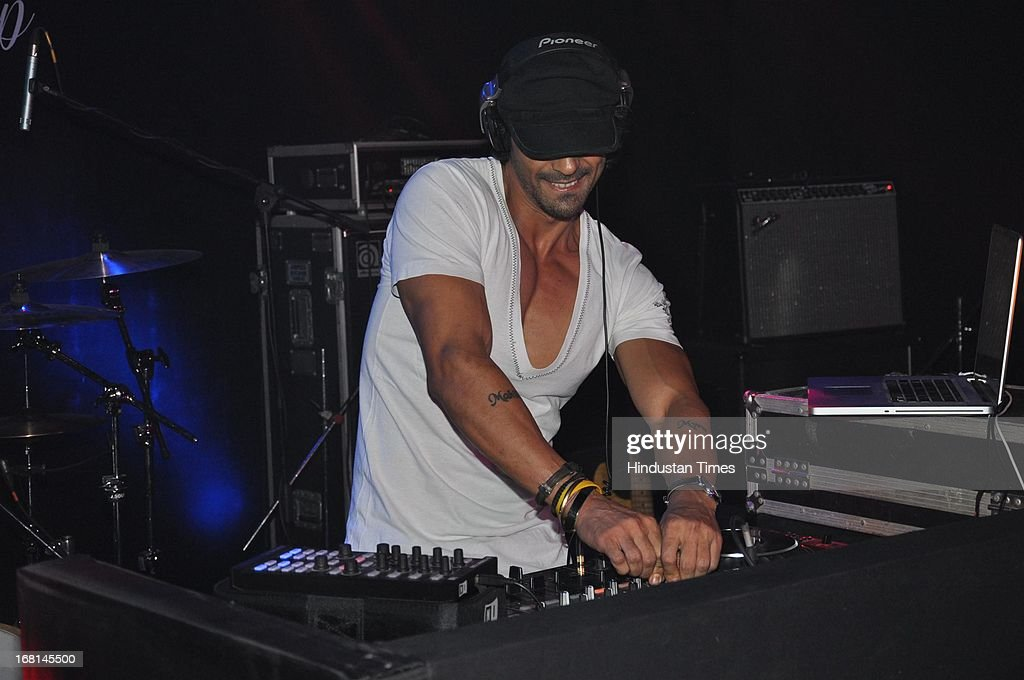 Indian Bollywood actor Arjun Rampal playing music during the Blackberrys Sharp Night Fashion Show at Mehboob studio, Bandra on May 3, 2013 in Mumbai, India. The Blackberrys Sharp Night is a fashion show organised by Blackberrys to showcase their new Summer/Spring collection.