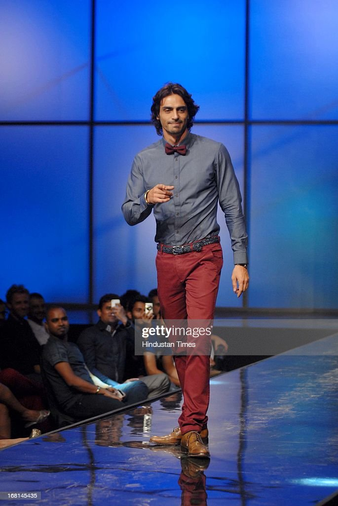 Indian Bollywood actor Arjun Rampal walks the ramp during the Blackberrys Sharp Night Fashion Show at Mehboob studio, Bandra on May 3, 2013 in Mumbai, India. The Blackberrys Sharp Night is a fashion show organised by Blackberrys to showcase their new Summer/Spring collection.