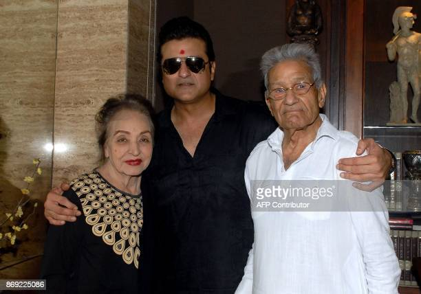 Indian Bollywood actor Armaan Kohli with his father film director and producer Rajkumar Kohali and his mother during the 'mahurat' auspicious...