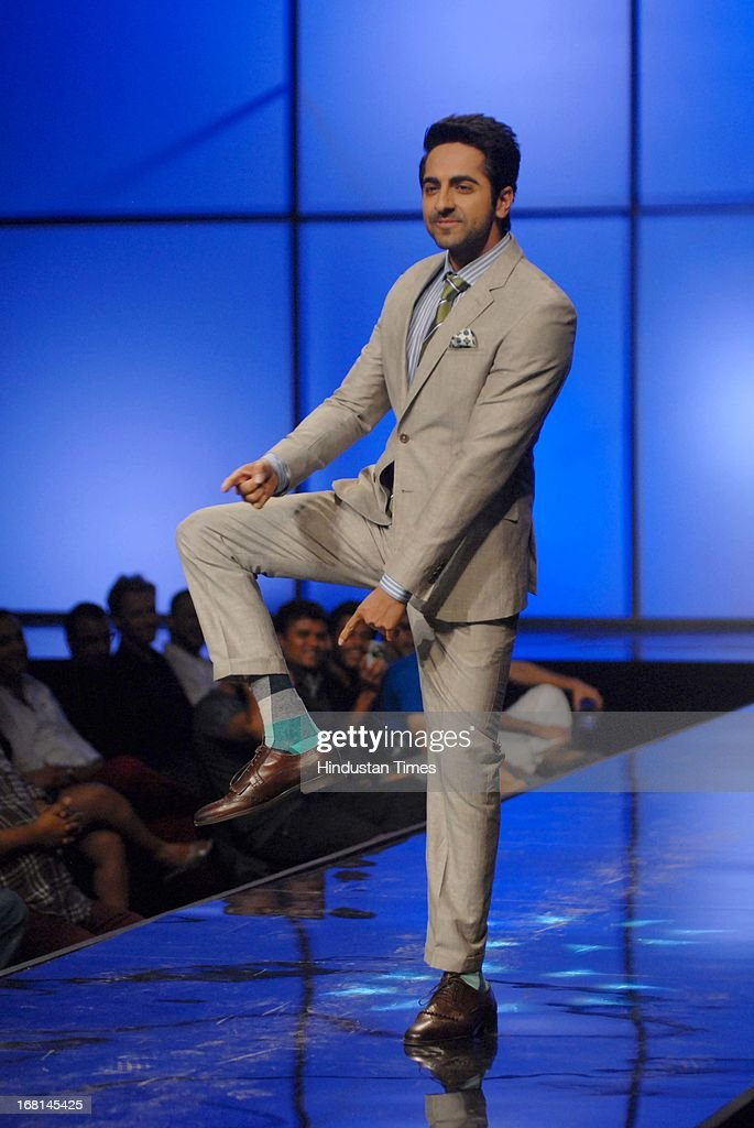 Indian Bollywood actor Ayushmann Khurrana walks the ramp during the Blackberrys Sharp Night Fashion Show at Mehboob studio, Bandra on May 3, 2013 in Mumbai, India. The Blackberrys Sharp Night is a fashion show organised by Blackberrys to showcase their new Summer/Spring collection.