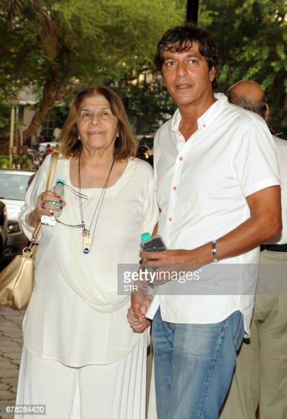 Indian Bollywood actor Chunky Pandey poses with his mother Snehlata Panday as they arrive to attend a prayer meeting for the late actor and...