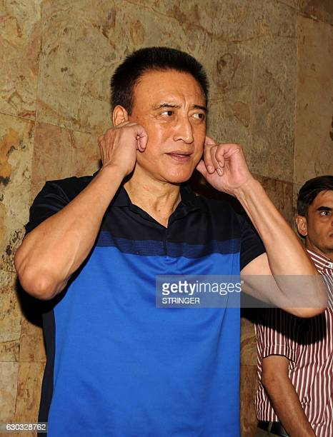 Indian Bollywood actor Danny Denzongpa attends the special screening of the biographical sports drama Hindi film 'Dangal' based on the life of...