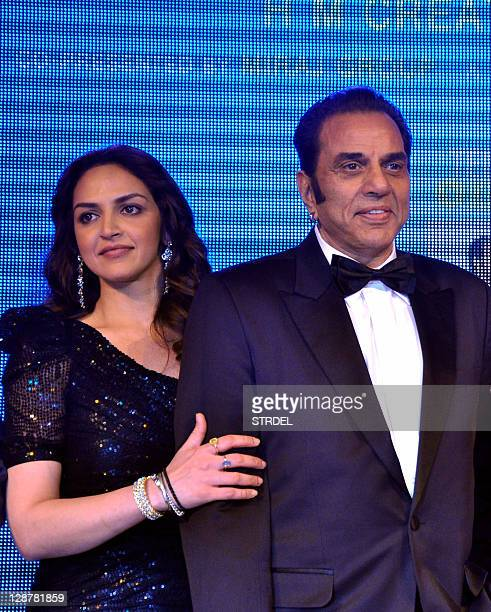 "Indian Bollywood actor Dharmendra and daughter actress Esha Deol pose during a function promoting the forthcoming Hindi film ""Tell Me O Khuda"" in..."