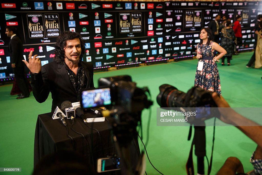 Indian Bollywood actor Dharshan Kumar poses on the green carpet few moments before the 17th edition of IIFA Awards (International Indian Film Academy Awards) in Madrid on June 25, 2016. The IIFA Awards are presented annually by the International Indian Film Academy to honour both artistic and technical excellence of professionals in Bollywood, the Hindi language film industry. / AFP / CESAR