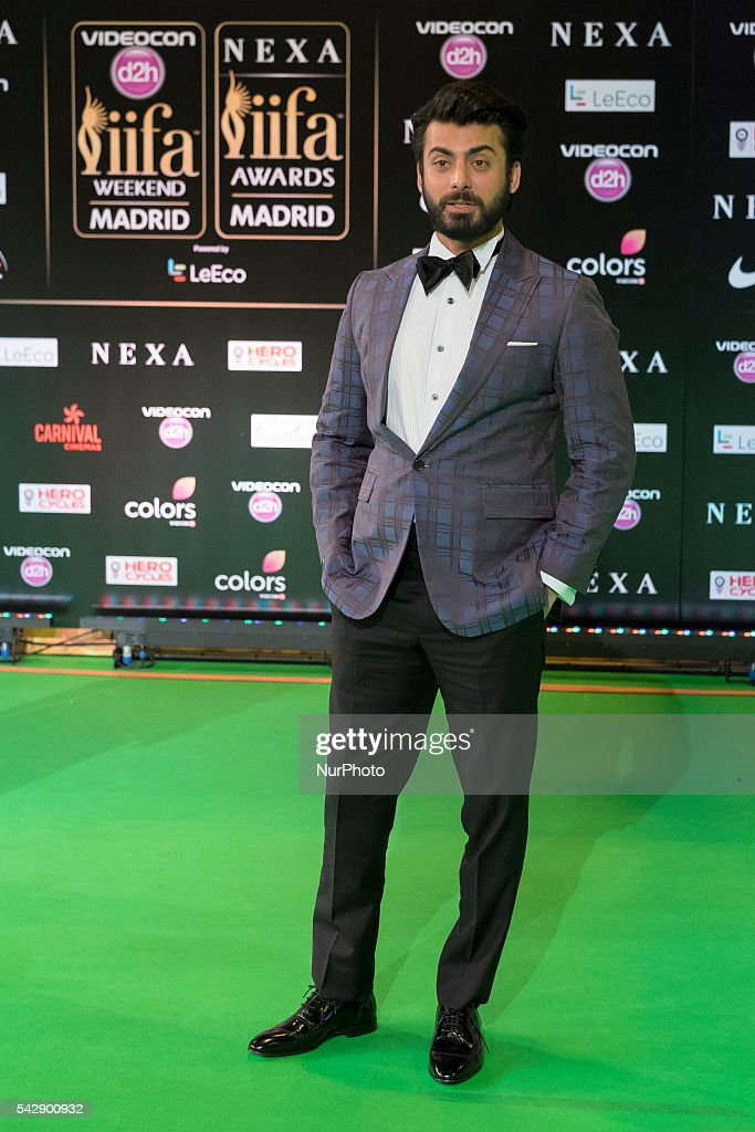 Indian Bollywood actor Fawad Khan poses on the green carpet as she arrives to the 17th edition of IIFA Awards (International Indian Film Academy Awards) in Madrid on June 24, 2016.