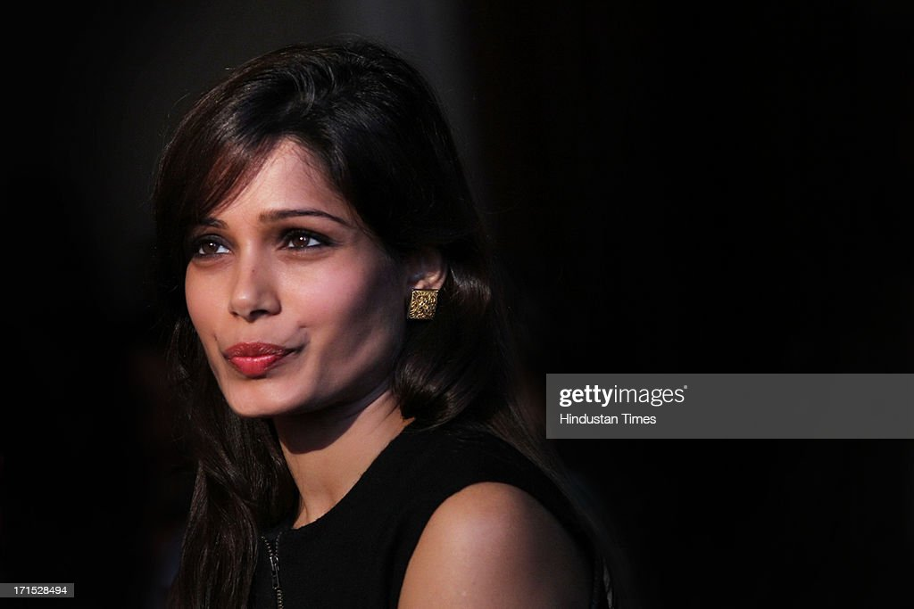 Indian Bollywood actor Freida Pinto poses for the camera during an exclusive profile shoot at The Oberoi Hotel on June 18, 2013 in New Delhi, India. Pinto, who lent her voice for one of the stories in the documentary feature film, Girl Rising, says the privileges she experienced growing up motivated her to be a part of this project.