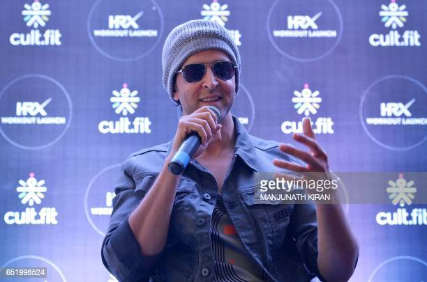 Indian Bollywood actor Hrithik Roshan addresses a press conference as launches a workout regime in Bangalore on March 11 2017 / AFP PHOTO / MANJUNATH...