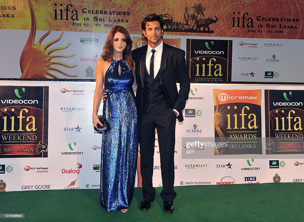 Indian Bollywood actor Hrithik Roshan (R) and his wife Suzanne arrive at the International Indian Film Academy (IIFA) awards in Colombo on June 5, 2010. Bollywood actors arrived in Sri Lanka to attend the three-day International Indian Film Academy (IIFA) awards and surrounding events that begun in Colombo on June 3. AFP PHOTO/ Punit PARANJPE