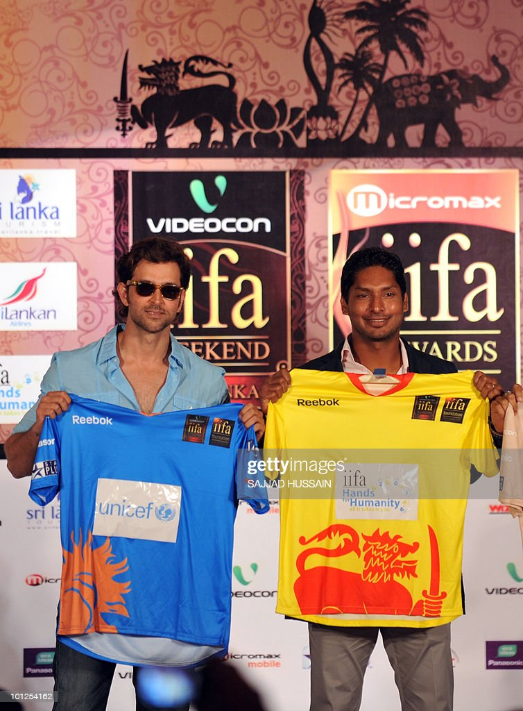 Indian Bollywood actor Hrithik Roshan and Sri Lankan cricketer Kumar Sangakkara hold up cricket jerseys at a news conference in Mumbai on May 29, 2010 to promote The International Indian Film Academy (IIFA) awards. Sri Lanka will host top Indian movie stars for the annual 'Bollywood Oscars' weekend that showcases one of the world's most ambitious and prolific film industries. The June 3-5 event will feature performances, premieres, celebrity parties, workshops, business forums, fashion shows and a Twenty20 cricket match. AFP PHOTO Sajjad HUSSAIN