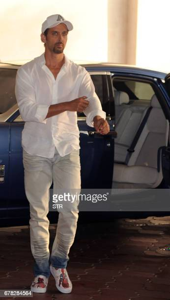 Indian Bollywood actor Hrithik Roshan arrives to attend a prayer meeting for the late actor and politician Vinod Khanna in Mumbai on May 3 2017 / AFP...