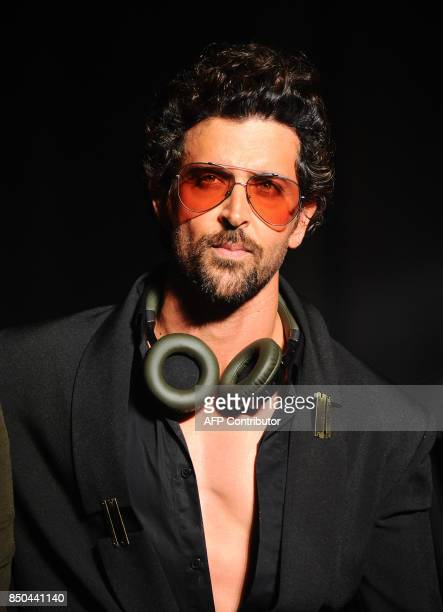 Indian Bollywood actor Hrithik Roshan showcases a creation by designer Nikhil Thampi during the Tech Fashion Tour Season 3 in Mumbai on late...