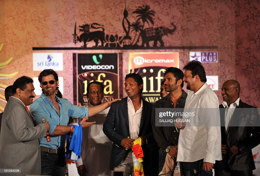 Indian Bollywood actor Hrithik Roshan, Sri Lankan Economic Development Minister Lakshman Yapa Abeywardena, Sri Lankan cricketer Kumar Sangakkara and Indian actors Suniel Shetty, Sanjay Dutt and Sri Lankan cricketer Sanath Jayasuriya laugh at a news conference in Mumbai on May 29, 2010 to promote The International Indian Film Academy (IIFA) awards. Sri Lanka will host top Indian movie stars for the annual 'Bollywood Oscars' weekend that showcases one of the world's most ambitious and prolific film industries. The June 3-5 event will feature performances, premieres, celebrity parties, workshops, business forums, fashion shows and a Twenty20 cricket match. AFP PHOTO Sajjad HUSSAIN