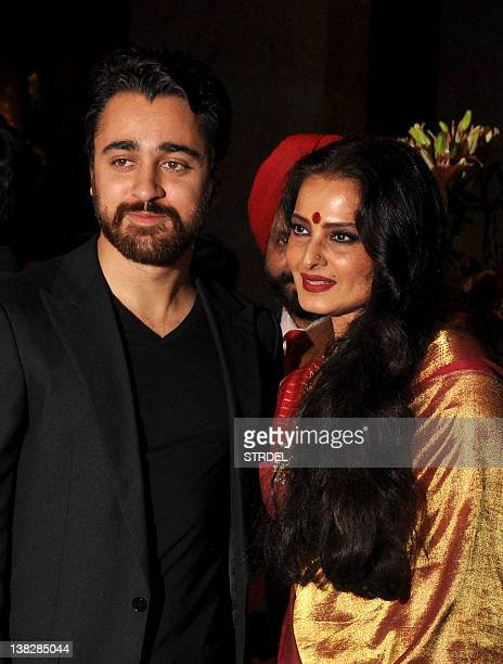 Indian Bollywood actor Imran Khan and actress Rekha attend the wedding reception of actors Ritesh Deshmukh and Genelia D'Souza in Mumbai on February...