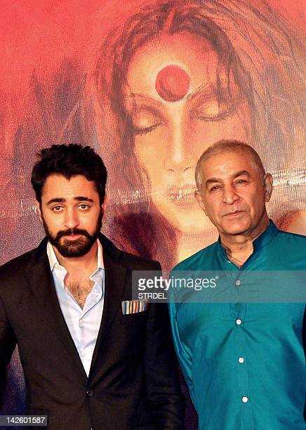 Indian Bollywood actor Imran Khan poses with fellow actor Dilip Tahil at the unveiling of a portrait of Khan's mother in law Vandana Malik from Maya...