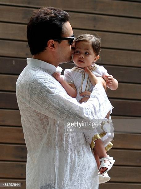 Indian Bollywood actor Imran Khan with his baby celebrates and wishes his fans Ramzan Eid Mubarak at his residence in Mumbai on July 18 2015 AFP PHOTO