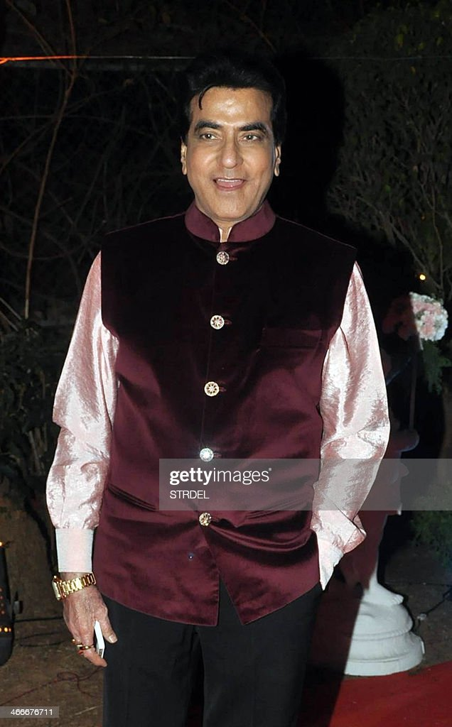 Indian Bollywood actor Jitendra poses as he attends the wedding reception of actress Ahana Deol and husband Vaibhav Vohra in Mumbai on February 2, 2014.