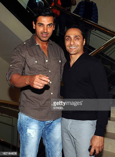 Indian bollywood actor John Abraham poses for a photo with actor Rahul Bose before a press conference for NGO fundraiser Equation 2013 founded by...