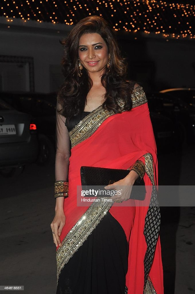 Indian Bollywood actor Karishma Tanna during the wedding reception of Bollywood playback singer Raghav Sachar and actor Amita Pathak on January 21, 2014 in Mumbai, India.