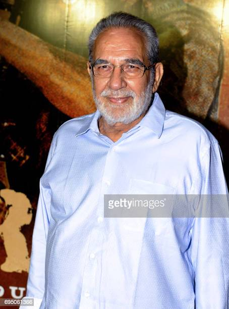 Indian Bollywood actor Kulbhushan Kharbanda poses for a photograph at the 20th anniversary celebration of Hindi film Border produced and directed by...